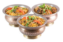 Indian risotto biryani in metal or bronze bowls on white background Royalty Free Stock Photo