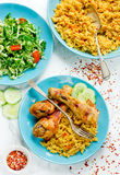 Indian roasted chicken with spicy basmati rice and fresh vegetab Royalty Free Stock Photos