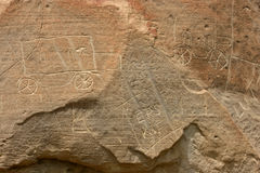 Indian Rock Carvings of Cars Stock Image