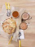 Indian Roti Prata. Roti Prata is often eaten with curry sauce and hot beverages as breakfast Stock Image