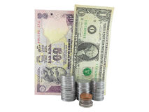 Indian Rupee and American Dollar. Indian and American Currency bills and coins Royalty Free Stock Photo