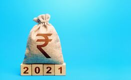 Indian rupee money bag and blocks 2021. Budget planning for next year. Revenues expenses, investment and financing. Beginning