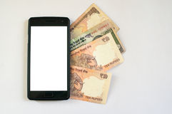 Indian rupee under a mobile Stock Photos