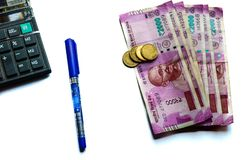 Indian rupees and coins stack, calculator and pen. royalty free stock images