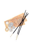 Indian rupees and incense sticks Stock Photos
