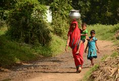 Indian Rural Family. Despite India's high level of economic growth, the majority of it's population in rural areas still struggle with hunger and Stock Photo