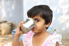Indian Rural Girl. Drinking water royalty free stock photography