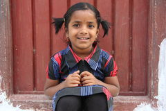 Indian Rural Girl. Sitting in front of the door Royalty Free Stock Photos