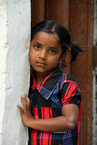 Indian Rural Girl. Standing in front of the door Stock Photography