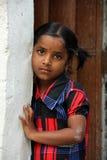 Indian Rural Girl. Standing in front of the door stock photography