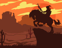 Indian's silhouette on horseback Stock Images