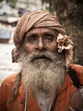 Indian Sadhu. Portrait of sadhu monk, solely dedicated to achieving the fourth and final Hindu goal of life, moksha (liberation Stock Photos
