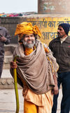 Indian Sadhu on ghat near sacred river Ganges in Varanasi Royalty Free Stock Photos