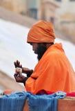 Indian Sadhu on ghat near sacred river Ganges in Varanasi Royalty Free Stock Image