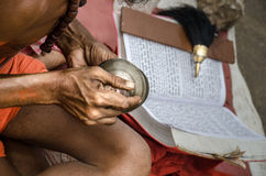 Indian Sadhu playing and reading in the street Stock Photography