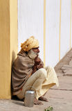 Indian sadhu sits on the street in Vrindavan Stock Photography