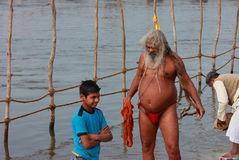Indian sadhu taking holy dip in river Ganga Royalty Free Stock Photo