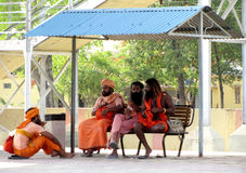 Indian sadhus sitting on a railway station Royalty Free Stock Images
