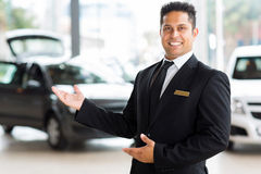 Indian salesman presenting Royalty Free Stock Photo