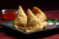 Indian samosa. Fresh Indian Samosa with green chilli and onion slices Stock Image