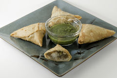 Indian Samosa Potato Pie. On a Plate with Green Salsa Stock Photos