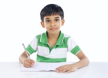 Indian School Boy Posing to Camera. With Book royalty free stock photography