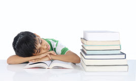 Indian School Boy. Sleeping on Book Stock Images