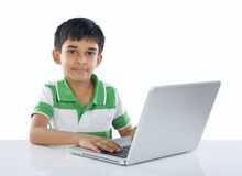 Indian School Boy With Laptop Royalty Free Stock Photography