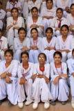 Indian school girls sitting at Qutub Minar, Delhi, India Stock Image