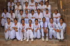 Indian school girls sitting at Qutub Minar, Delhi, India Stock Photography