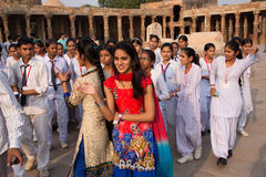 Indian school students standing in the courtyard of Quwwat-Ul-Is Stock Photo
