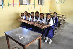 Indian schoolgirls in the classroom royalty free stock photography