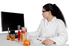 Indian scientist using a computer on studio Stock Photos