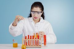 Indian scientist working with chemicals stock images
