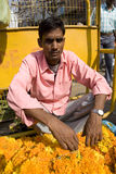 Indian seller of flowers. Royalty Free Stock Photography