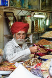 Indian Seller In The Market. Indian man selling dried fruits in the market in Delhi Royalty Free Stock Photos