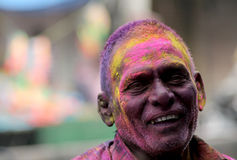 Indian senior  Hindu man celebrate Holi or indian hindu festival of colors an annual event Royalty Free Stock Images