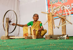 Indian senior woman spinning thread for handloom Royalty Free Stock Images