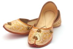 Indian shoes. Indian handicraft beige deseigner shoes Stock Images