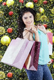 Indian shopaholic holds shopping bags Royalty Free Stock Photos