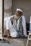Indian Shopkeeper relaxing Stock Images