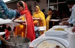 Indian sikh women take their lunch in their temple during Baisakhi celebration in Mallorca. Indian Sikh women have their lunch in their temple during their Stock Photography