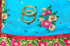 Indian Silk Saree. Indian pure silk saree worn by the Indian women for wedding and festivals. Made of gold zari and pure silk. Matching stone bangles Royalty Free Stock Photos