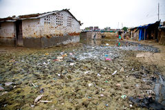 Indian Slum. Slum in Delhi India with dirt and mud in foreground royalty free stock images