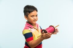 Indian small kid or boy holding spindal or chakri on Makar Sankranti festival, ready to fly Kite Stock Photos