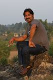 Indian smoking and smiling Stock Photos