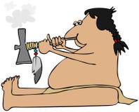 Indian smoking a tomahawk peacepipe Royalty Free Stock Photo
