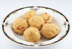Indian snack. Popular sweet Indian snack on a white plate royalty free stock image