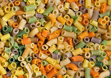 Indian Snack As a Colorful Pattern. A colorful pattern from pile of Indian snacks Stock Photos
