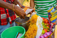 Indian Snack Bhel Puri. A bhel puri seller making this delicious indian snack for his customer Royalty Free Stock Image